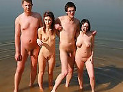 Couples switching partners on the nudist beach